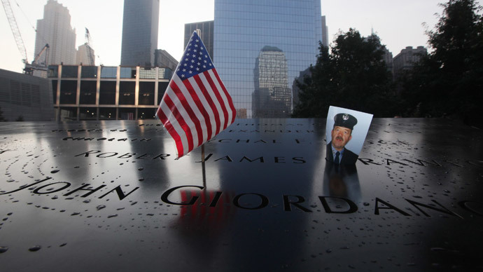 A picture of New York City firefighter James Crawford, one of the thousands of people who died of the attacks of September 11, 2001, is seen at the 9/11 Memorial ceremonies marking the 12th anniversary of the 9/11 attacks on the World Trade Center in New York, September 11, 2013.(Reuters / Chris Pedota)
