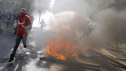 Student protesters run away during a demonstration to demand changes in the Chilean education system, in Santiago May 8, 2014. (Reuters/Ivan Alvarado)