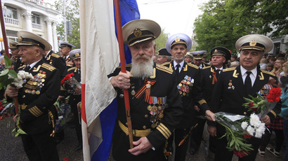 Russian veterans march with a Soviet navy flag to mark Victory Day in the Crimean port of Sevastopol May 9, 2014. (Reuters)