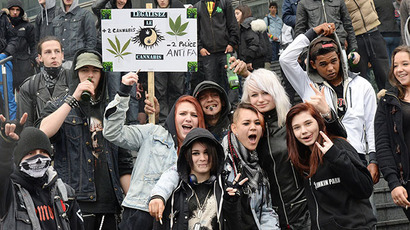"People pose in front a placard reading ""Legalize cannabis"" as they take part in a protest to call for the legalization of marijuana on May 10, 2014 in Paris. (AFP Photo / Pierre Andrieu)"