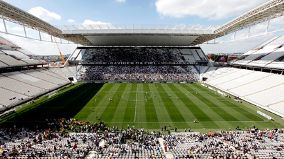 A general view is seen of the Arena de Sao Paulo Stadium, one of the venues for the 2014 World Cup, during a soccer match test in the Sao Paulo district of Itaquera May 10, 2014 (Reuters / Paulo Whitaker)