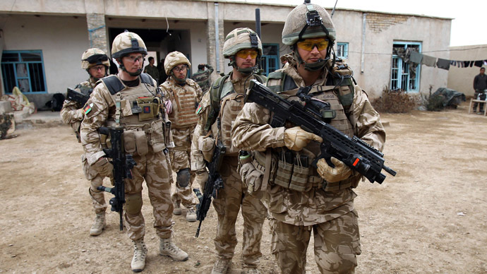 British soldier Lieutenant-Colonel Nick Lock (2L) gathers his soldiers of the 1st Batallion of the Royal Welsh before a patrol in the streets of Showal in Nad-e-Ali district, Southern Afghanistan, in Helmand Province on February 25, 2010. (AFP Photo/Thomas Coex)