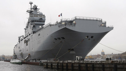 France's Mistral amphibious helicopter carrier ship docks on the Neva River in St. Petersburg November 23, 2009. (Reuters/Alexander Demianchuk)
