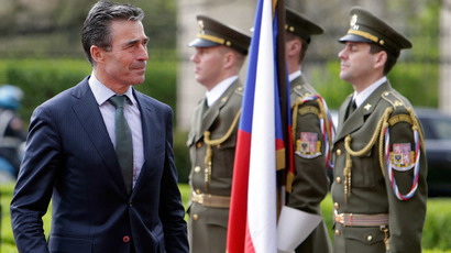 NATO Secretary General Anders Fogh Rasmussen walks past the guard of honour at the Czech government headquarters in Prague April 10, 2014. (Reuters / David W Cerny)