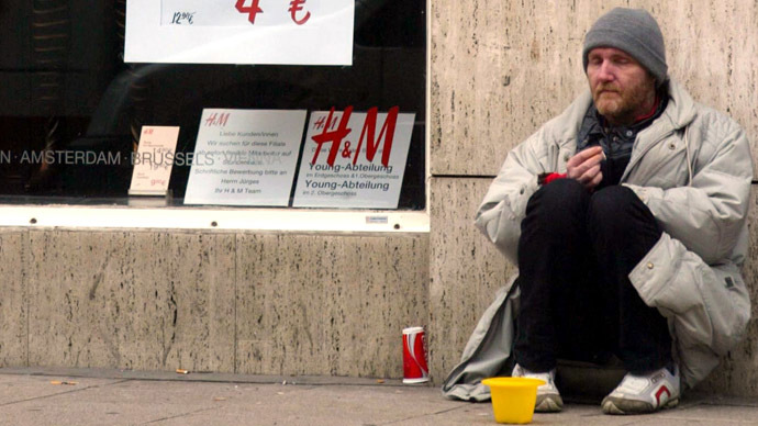 A homeless man begs for money near a shop in Hamburg, Germany. (AFP Photo/Marcus Brandt)