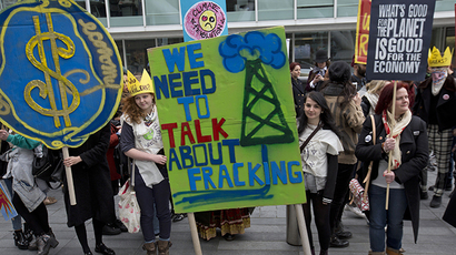 Demonstrators hold banners during an anti-fracking protest in central London March 19, 2014. (Reuters / Neil Hall)