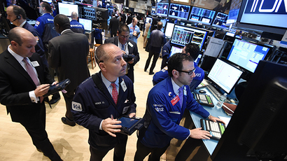 Traders work on the floor of the New York Stock Exchange (AFP Photo / Stan Honda)