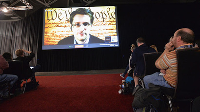 "NSA whistleblower Edward Snowden speaks via videoconference at the ""Virtual Conversation With Edward Snowden"" during the 2014 SXSW Music, Film + Interactive Festival at the Austin Convention Center on March 10, 2014 in Austin, Texas.   (AFP Photo / Getty Images / Michael Buckner)"