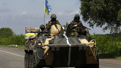 A Ukrainian army armoured fighting vehicle patrols north of the eastern Ukrainian town of Slavyansk May 13, 2014. (Reuters/Yannis Behrakis)