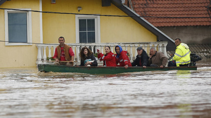 People sit in a boat after being evacuated from their flooded houses in the town of Obrenovac, east from Belgrade May 16, 2014. (Reuters/Marko Djurica)