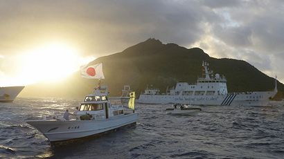 FILE photo. Chinese marine surveillance ship Haijian No. 51 (C) sails near Japan Coast Guard vessels (R and L) and a Japanese fishing boat (front 2nd L) as Uotsuri island, one of the disputed islands, called Senkaku in Japan and Diaoyu in China (Reuters / Kyodo)