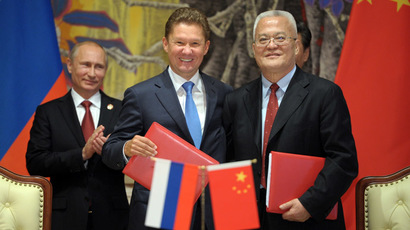 May 21, 2014. From left: President Vladimir Putin, Gazprom CEO Alexei Miller and CNPC Chairman Zhou Jiping during the signing of joint agreements in Shanghai. (RIA Novosti/Alexei Druzhinin)