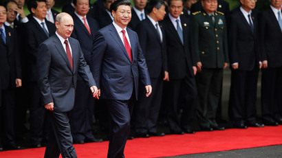 China's President Xi Jinping (front R) walks with Russia's President Vladimir Putin during a welcoming ceremony at the Xijiao State Guesthouse ahead of the fourth Conference on Interaction and Confidence Building Measures in Asia (CICA) summit in Shanghai on May 20, 2014.(AFP Photo / Carlos Barria)