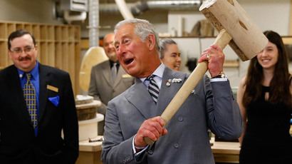 Britain's Prince Charles hefts a wooden mallet while touring a heritage retrofit carpentry exhibit at Holland College in Charlottetown, Prince Edward Island, May 20, 2014.(Reuters / Mark Blinch )
