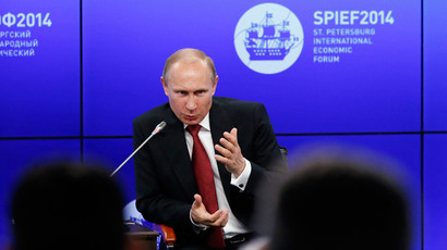 Russia's President Vladimir Putin speaks during a session of the St. Petersburg International Economic Forum 2014 (SPIEF 2014) in St. Petersburg May 23, 2014.(Reuters / Sergei Karpukhin)