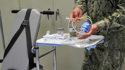 A US naval medic holds liquid food supplement force fed to hunger strikers at the US Naval Base in Guantanamo Bay, Cuba (AFP Photo/Chantal Valery)