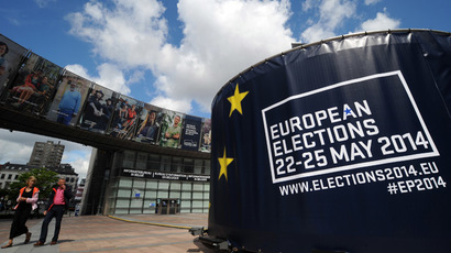 People walk in front of visuals promoting elections in front of the European Parliament in Brussels, May 24, 2014. (Reuters/Eric Vidal)