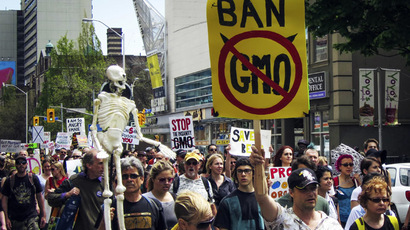 "A protester holds a sign reading ""Ban GMO"" (Genetically Modified Organism) in the ""March Against Monsanto"" in Toronto, May 24, 2014. (Reuterts/Mark Blinch)"
