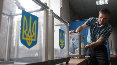 A member of the election commission prepares ballot boxes at one of the polling stations in Kiev on May 24, 2014, a day before the presidential election in Ukraine. (AFP Photo/Anatolii Stepanov)