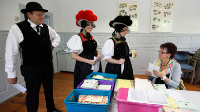People in traditional clothes arrive at a polling station to cast their votes for the European Parliament elections in Hornberg near Freiburg May 25, 2014. (Reuters / Ralph Orlowski)