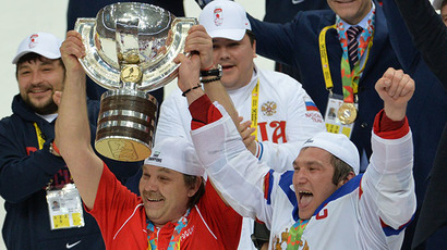 Russia's head coach Oleg Znarok (L) and Alexander Ovechkin celebrate with the trophy after winning their men's ice hockey World Championship final game, May 25, 2014. (RIA Novosti / Alexei Kudenko)