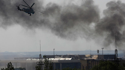 A Ukrainian helicopter Mi-24 gunship fires its cannons against anti-government forces at the main terminal building of Donetsk international airport May 26, 2014. (Reuters / Yannis Behrakis)