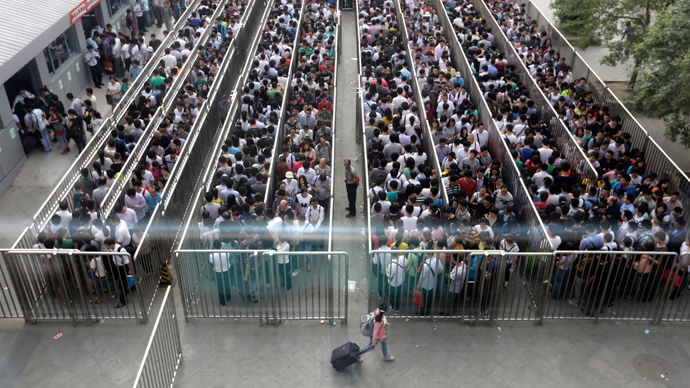 Security check during morning rush hour at Tiantongyuan North Station in Beijing May 27, 2014 (Reuters / Jason Lee)