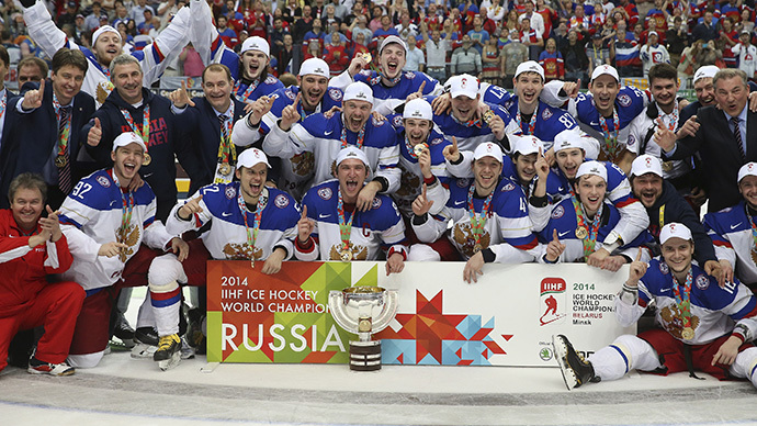 Russia's players and officials celebrate with the trophy after winning their men's ice hockey World Championship final game against Finland at Minsk Arena in Minsk May 25, 2014. (Reuters / Vasily Fedosenko)