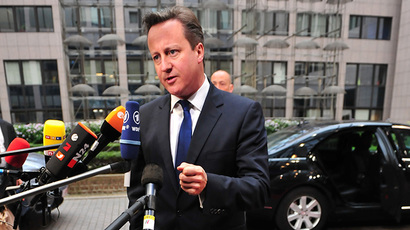 Britain Prime minister David Cameron answers journalists' questions on May 27, 2014 as he arrives to take part in the Informal European Council at the EU Headquarters in Brussels. (AFP Photo / Georges Gobet)