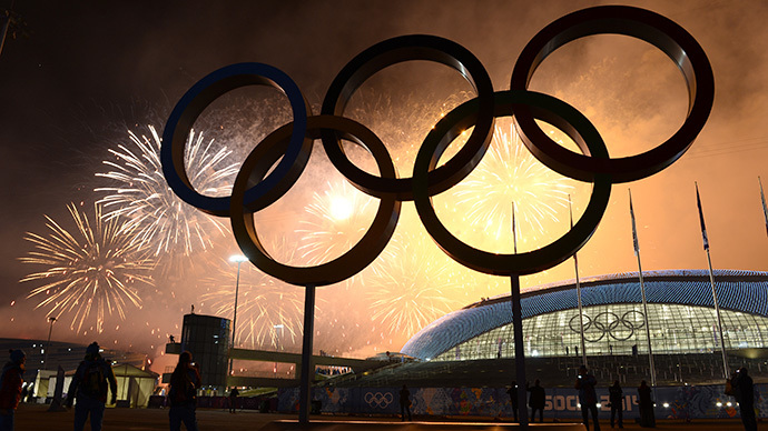 Fireworks explode around the Fisht Olympic Stadium at the end of the Closing Ceremony of the Sochi Winter Olympics on February 23, 2014 at the Olympic Park in Sochi. (AFP Photo / Jonathan Nackstrand)