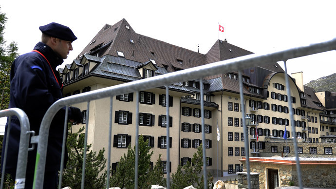 A private policeman guards on June 9, 2011 the Suvretta House five-star hotel in the chic Swiss ski station of St Moritz, where the Bilderberg Group is holding its annual meeting.(AFP Photo / Fabrice Coffrini)