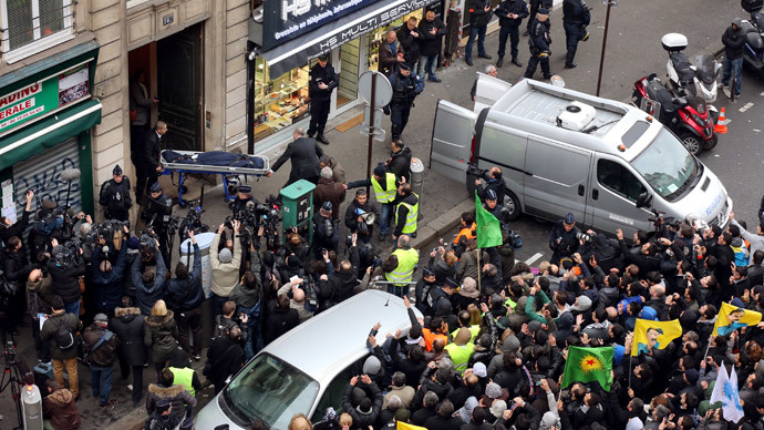 ARCHIVE PHOTO: Members of the Kurdish community in France demonstrate on January 10, 2013 in Paris while two men (L) carry the body of one of the three Kurdish women shot dead at the Kurdistan Information Bureau. (AFP Photo / Thomas Samson)