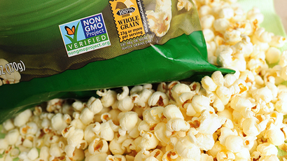 A label on a bag of popcorn indicates it is a non-GMO food product, in Los Angeles, California (AFP Photo / Robyn Beck)