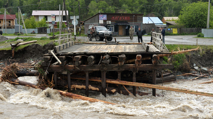 A bridge over the Chemalka river destroyed by flooding in Chemal village. Heavy showers swell rivers which caused floods in the Republic of Khakassia and the Altai Territory.(RIA Novosti / Alexandr Kryazhev)