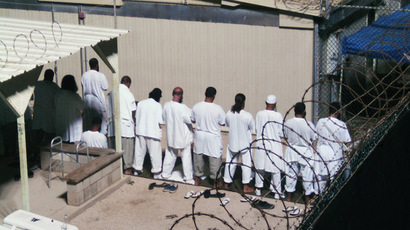 Detainees participate in an early morning prayer session at Camp IV at the detention facility in Guantanamo Bay U.S. Naval Base (Reuters/Deborah Gembara)