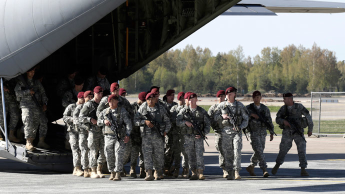 First company-sized contingent of about 150 U.S. paratroopers from the U.S. Army's 173rd Infantry Brigade Combat Team based in Italy arrive in the airport in Riga April 24, 2014. (Reuters / Ints Kalnins)