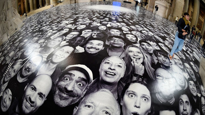 "People visit the exhibition ""Au Pantheon!"" by French photographer JR at the Pantheon in Paris, a secular temple which contains the remains of distinguished French citizens, on June 3, 2014. (AFP Photo / Martin Bureau)"