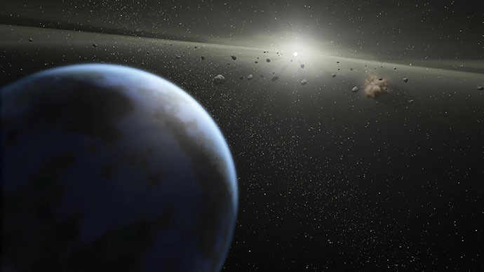 An artist's illustration that shows a massive asteroid belt in orbit around a star the same age and size as our Sun. (AFP Photo / NASA)
