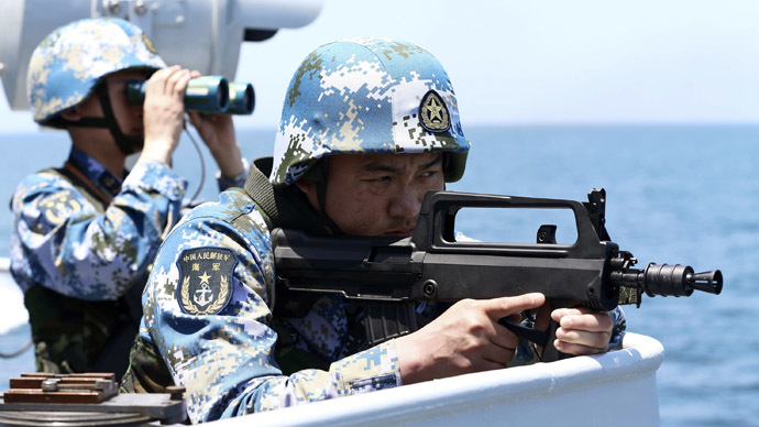 Chinese soldiers take part in Joint Sea-2014 naval exercise outside Shanghai on the East China Sea, May 23, 2014. (Reuters/China Daily)
