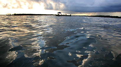 OIl sheen sits on the surface of Barataria Bay June 19, 2010 west of Port Sulpher, Louisiana. (AFP Photo / Getty Images / Sean Gardner)
