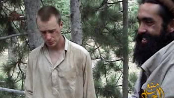 This still image provided on December 7, 2010 by IntelCenter shows the Taliban associated video production group Manba al-Jihad December 7, 2010 release of someone that appears to be US soldier Bowe Bergdahl (L), who has been held hostage by the Taliban since his disappearance from his unit on June 30, 2009. (AFP Photo)