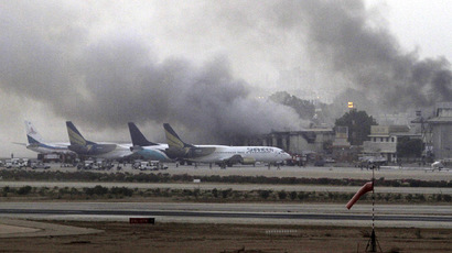 Smoke billows from Jinnah International Airport in Karachi June 9, 2014. (Reuters/Athar Hussain)