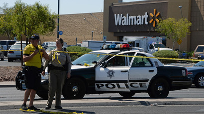 Las Vegas Metropolitan Police Department officers put police tape up outside a Wal-Mart on June 8, 2014 in Las Vegas, Nevada.(AFP Photo /  Ethan Miller)