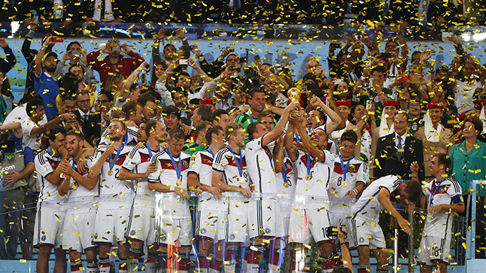 Germany's players lift the World Cup trophy as they celebrate their 2014 World Cup final win against Argentina at the Maracana stadium in Rio de Janeiro July 13, 2014. (Reuters / Michael Dalder)