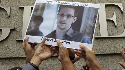 Protesters supporting Snowden hold a photo of him during a demonstration outside the U.S. Consulate in Hong Kong (Reuters / Bobby Yip)