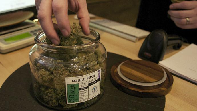 "Co-owner Troy Moore measures marijuana at the ""Oregon's Finest"" medical marijuana dispensary in Portland, Oregon April 8, 2014. (Reuters)"