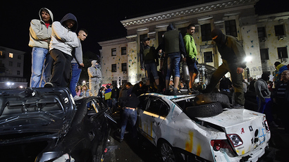 Protesters stand on top of the crashed cars during a rally against the Russian President Vladimir Putin in front of the Russian embassy in Kiev on June 14, 2014 (AFP Photo / Sergey Supinsky)