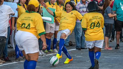 Prostitutes play a football match against a university team to protest against women exploitation at Guaicurus Street in Belo Horizonte, Brazil on June 14, 2014. (AFP Photo / Gustavo Andrade)