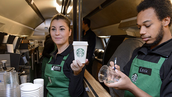 US coffee giant Starbucks employee Essia (L) and Egole prepare beverages. (AFP Photo / Fabrice Coffrini)
