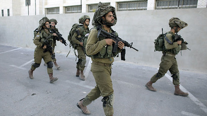 Israeli soldiers patrol during an operation to locate three Israeli teens in the West Bank City of Hebron June 16, 2014. (Reuters / Ammar Awad)